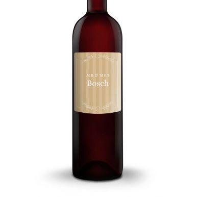 Fles wijn met eigen etiket